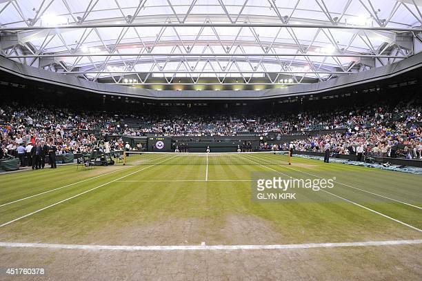 A picture shows Centre Court on day twelve of the 2014 Wimbledon Championships at The All England Tennis Club in Wimbledon southwest London on July 5...