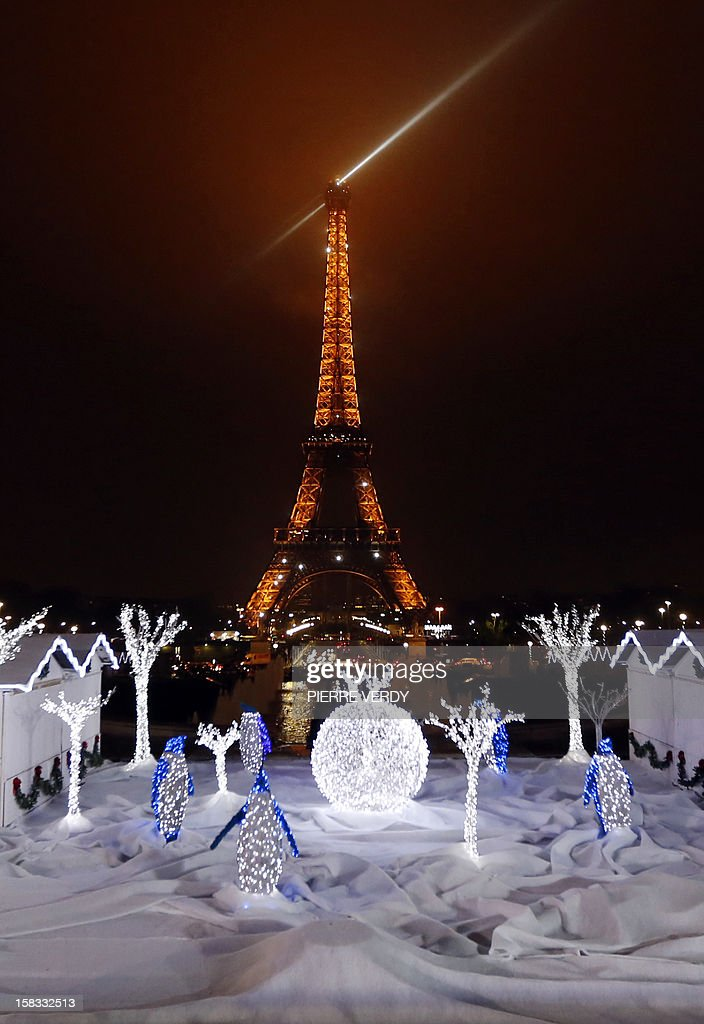 A picture shows Christmas decorations in front of the Eiffel tower, on December 13, 2012, in Paris, as part of the 'Trocadero On Ice' event. An ice-skating rink opened to public in front of the Eiffel tower, and will run until January 6, 2013.