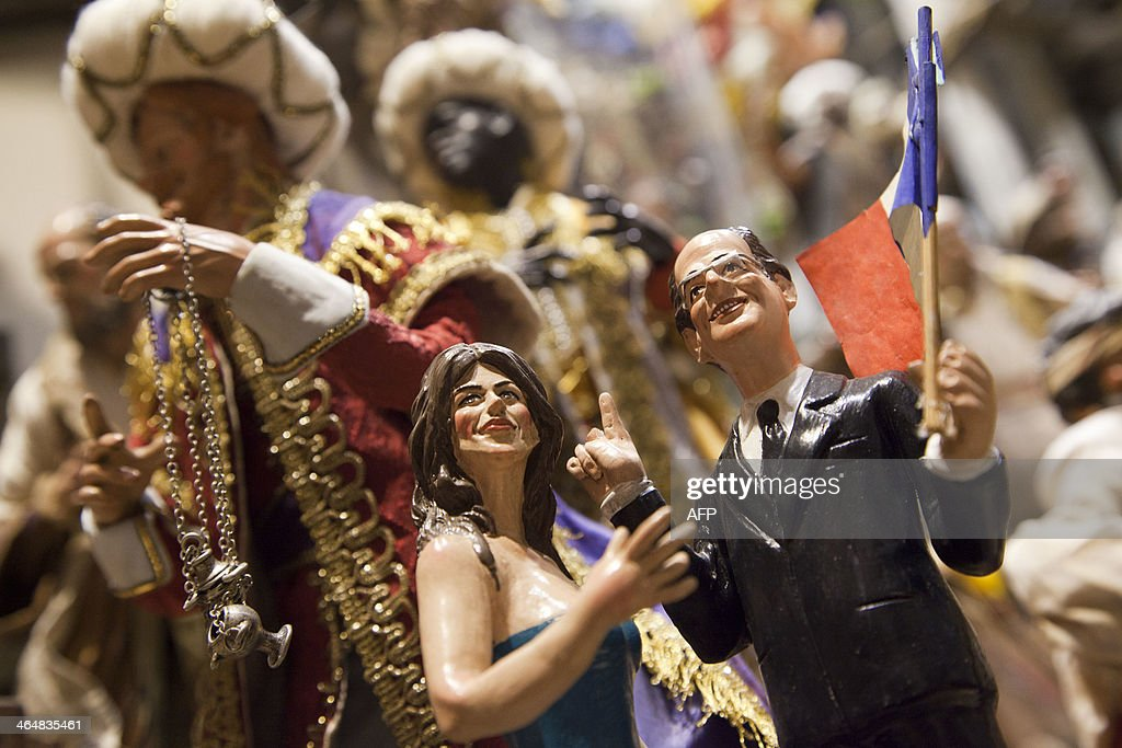 A picture shows Christmas figurines representing French President Francois Hollande and actress Julie Gayet on January 24, 2013 in Genny Di Virgilio's shop in San Gregorio Armeno street in Naples, a narrow street often called the street of nativity workshops or Christmas Alley.