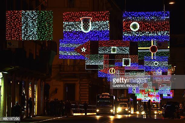 A picture shows christmas lights representing the national flags of different countries in the Via del Corso in Rome on December 9 2014 AFP PHOTO /...