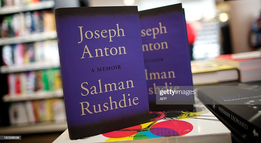 A picture shows copies of the book 'Joseph Anton' a memoir by British author Salman Rushdie in a book shop in central London on September 18, 2012. As violent protests over a US-made film rock the Muslim world, Salman Rushdie publishes his account on September 18 of the decade he spent in hiding while under a fatwa for his book 'The Satanic Verses'. With at least 19 people killed in a week of furious protests over the film, Rushdie's candid memoir of the years spent on the run after he too was accused of mocking Islam, entitled 'Joseph Anton', has an added resonance. AFP PHOTO / ANDREW COWIE