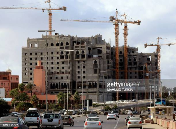A picture shows cranes surrounding a construction site which started during the regime of ousted dictator Moamer Khadafi and has since been put on...