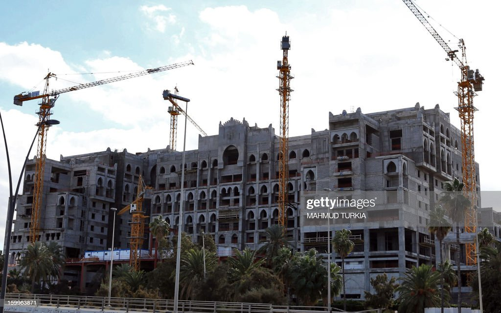 A picture shows cranes surrounding a construction site which started during the regime of ousted dictator Moamer Khadafi and has since been put on hold, on January 23, 2013 in Tripoli.