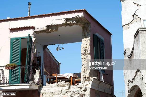 A picture shows damage caused on houses in Casamicciola Terme on the Italian island of Ischia on August 22 after an earthquake hit the popular...
