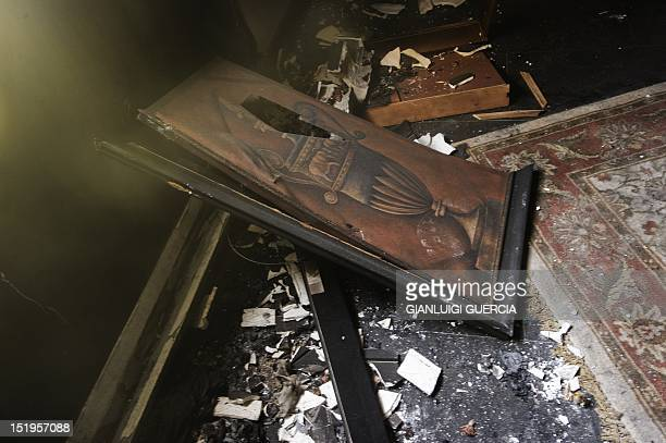 A picture shows damage inside the burnt US consulate building in Benghazi on September 13 following an attack on the building late on September 11 in...