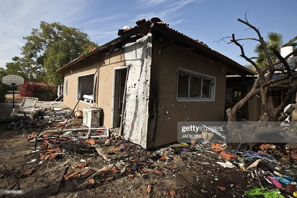 A picture shows damage to an Israeli house after it was hit by a rocket launched by Palestinian militants from the Gaza Strip in the southern Israeli town of Beer Tuvia on November 21, 2012. Atleast 17 people were injured in an explosion on a bus near the defence ministry in Tel Aviv, Israel's emergency services said, in what an official said was a 'terrorist attack.'