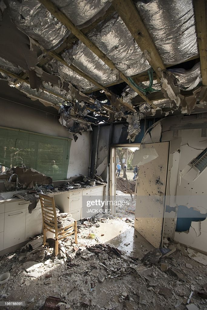 A picture shows damage to an Israeli house after it was hit by a rocket launched by Palestinian militants from the Gaza Strip in the southern Israeli town of Beer Tuvia on November 21, 2012. Atleast 17 people were injured in an explosion on a bus near the defence ministry in Tel Aviv, Israel's emergency services said, in what an official said was a 'terrorist attack.' AFP PHOTO / JACK GUEZ