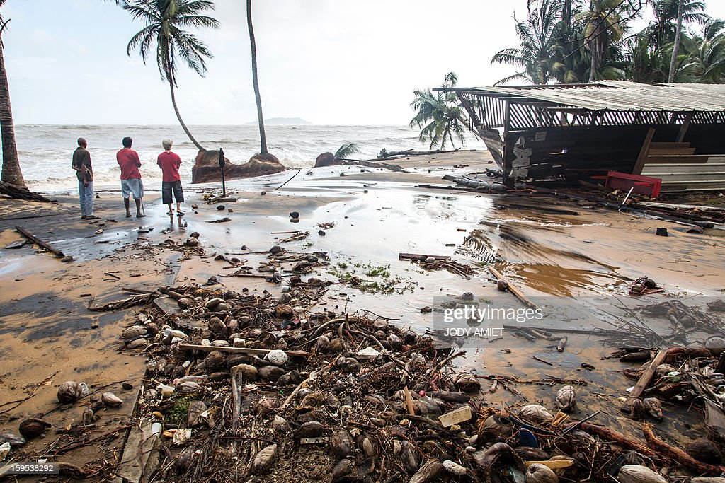 A picture shows damages after waves hit the coast near Cayenne on January 15, 2013. The coast of Guyana switched to 'red alert' today as several houses of Rémire-Montjoly (10 km from Cayenne) have been 'damaged' due to high tides, the prefecture of Guyana said in a statement.