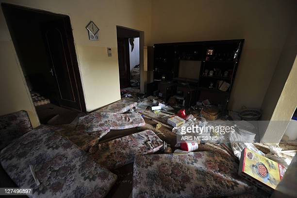 A picture shows damages at the house of Libyan regime loyalists in Tawarga on September 25 2011 The people of Tawarga who are mostly blackskinned...