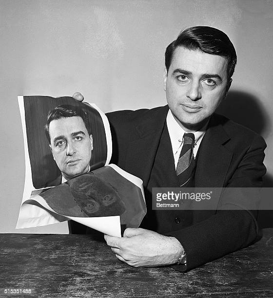 Picture shows Edwin H Land showing positive and negative print taken from a new camera that produces finished pictures