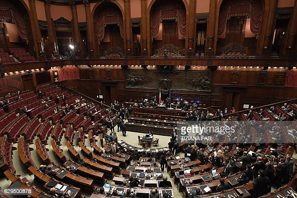 A picture shows empty seats at the Italian Chamber of Deputies as Five Star Movement deputies and farright party Lega Nord deputies leave the...