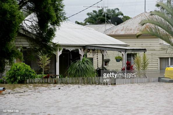 A picture shows flooded homes in Bundaberg Queensland on December 29 2010 as entire towns in the state suffer the worst deluge in decades Drenching...