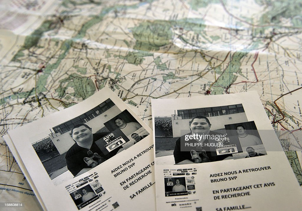 A picture shows flyers with pictures of Bruno, a young trisomic man reported missing since December 18, as French Gendarmes and volunteers take part in searches to find him on December 30, 2012 in Pimprez.