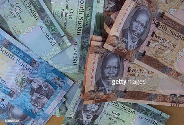A picture shows freshlyminted notes of the new South Sudan pound which pictures the late South Sudanese independence leader John Garang in Juba on...