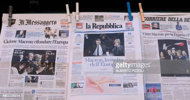 A picture shows front pages of Italian newspapers reporting on results of France's presidential election on May 8 2017 in Rome Almost definitive...