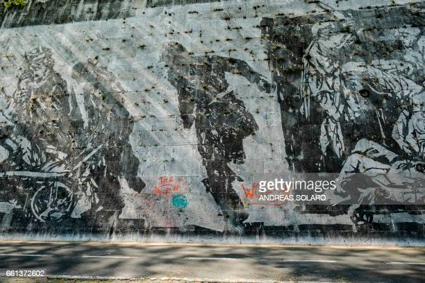 A picture shows graffitis painted on the 'Triumphs and Laments' frescoe which was completed along the banks of Romes Tiber river less than a year ago...