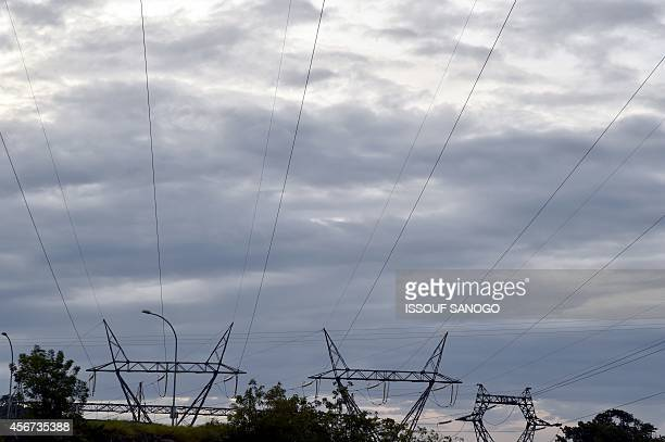 A picture shows high tension power lines near the Kossou dam one of the six hydroelectric power stations launched in Ivory Coast in 1972 on September...
