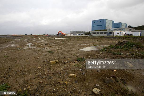 A picture shows Hinkley Point A to the right of development land where the reactors of Hinkly C nuclear power station at Hinkley Point will be built...