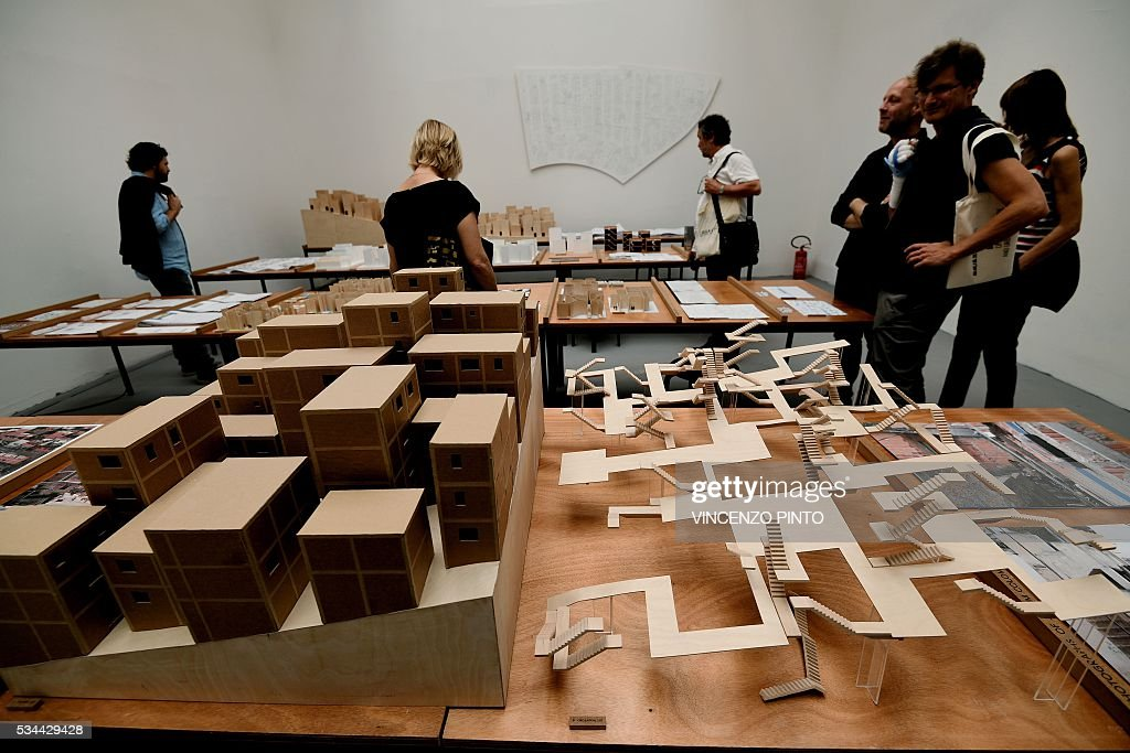 A picture shows houses projects for Brazil made by Suiss architect Christian Kerez, during the opening of the 15th International Architecture Exhibition in Venice on May 26, 2016. The Biennale, entitled 'Reporting from the front', curated by Chilean Alejandro Aravena will be open to the public from May 28 through November 27, 2016, in The Arsenal gardens. / AFP / VINCENZO