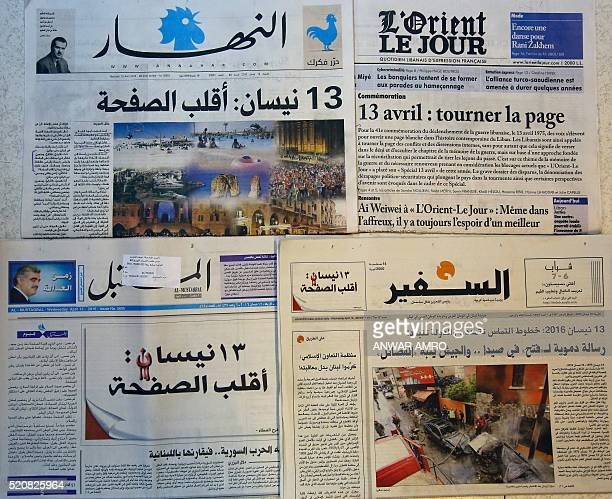 A picture shows Lebanese newspapers with its front pages appealing for readers to 'turn the page' on sectarian divisions on the 41st anniversary of...