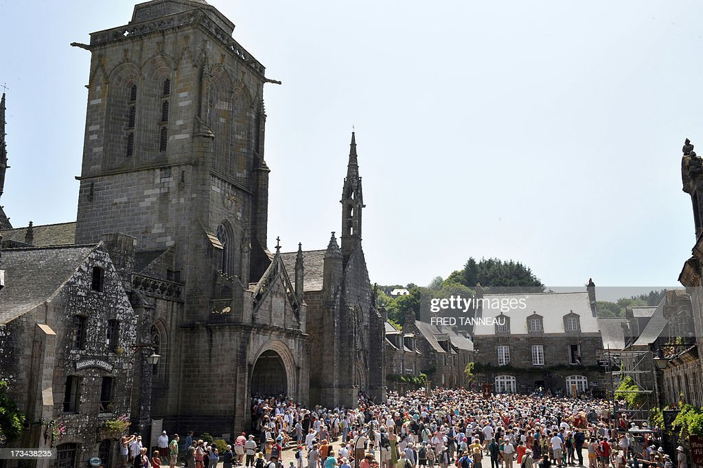 A picture shows Locrinan's church as pilgrims take part in the 'Grande Tromenie', on July 14, 2013 in Locronan in Brittany, western France, one of the oldest Breton 'pardons', a procession which gathers thousands of Catholic pilgrims. The religious event old of at least 500 years takes place every six years, gathering thousands of pilgrims who walk and pray, following 5th and 6th century Irish evangelist monk Saint-Ronan's footsteps.