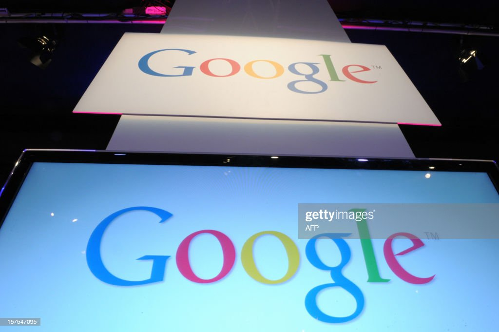A picture shows logos of Google on December 4, 2012 during LeWeb Paris 2012 in Saint-Denis near Paris. Le Web is Europe's largest tech conference, bringing together the entrepreneurs, leaders and influencers who shape the future of the internet. AFP PHOTO ERIC PIERMONT