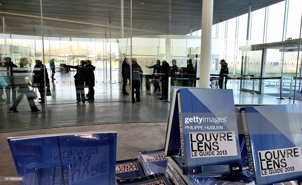 A picture shows Louvre-Lens museum's guide books 2013 on December 8, 2012 in Lens, northern France. The Louvre museum opened a new satellite branch among the slag heaps of a former mining town on Dcember 4, 2012 in a bid to bring high culture and visitors to one of France's poorest areas.