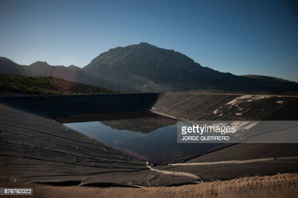 A picture shows low water levels at a reservoir in droughtstricken Albanchez de Magina near Jaen on November 20 2017 Spain and Portugal are grappling...
