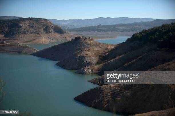 A picture shows low water levels due to drought at the Iznajar reservoir near Cordoba on November 20 2017 Spain and Portugal are grappling with a...