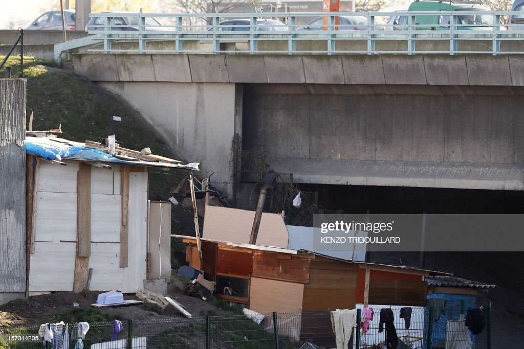 A picture shows makeshift homes near the ring motorway around Paris on December 2, 2012.