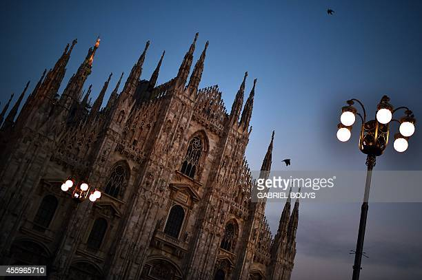 A picture shows Milan's Duomo on September 21 2014 at sunset AFP PHOTO / GABRIEL BOUYS
