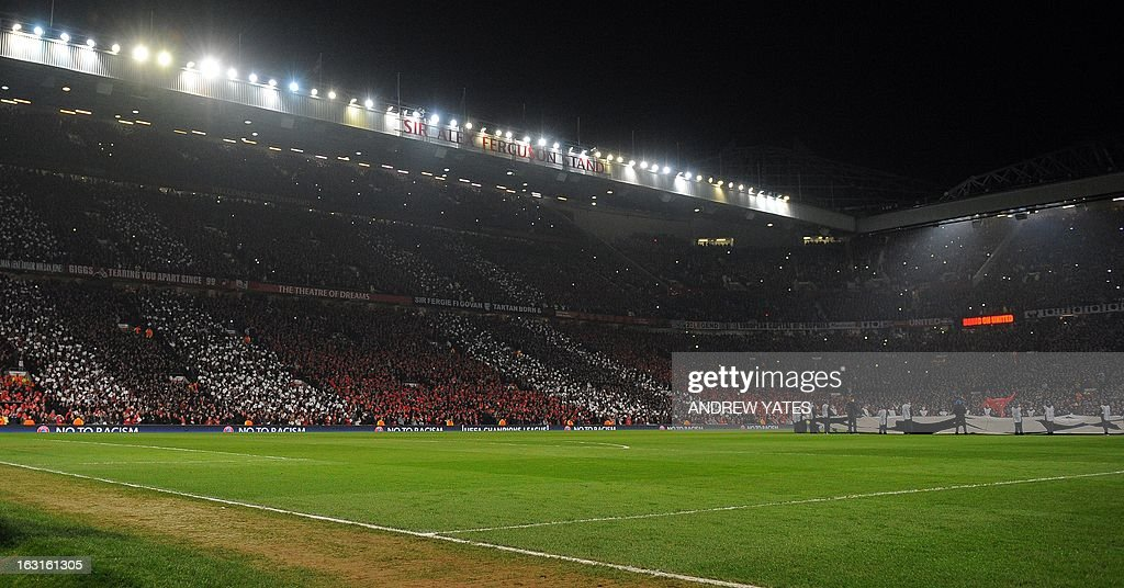 A picture shows mosaics in the crowd before the UEFA Champions League round of 16 second leg football match between Manchester United and Real Madrid at Old Trafford in Manchester, northwest England on March 5, 2013. AFP PHOTO / ANDREW YATES