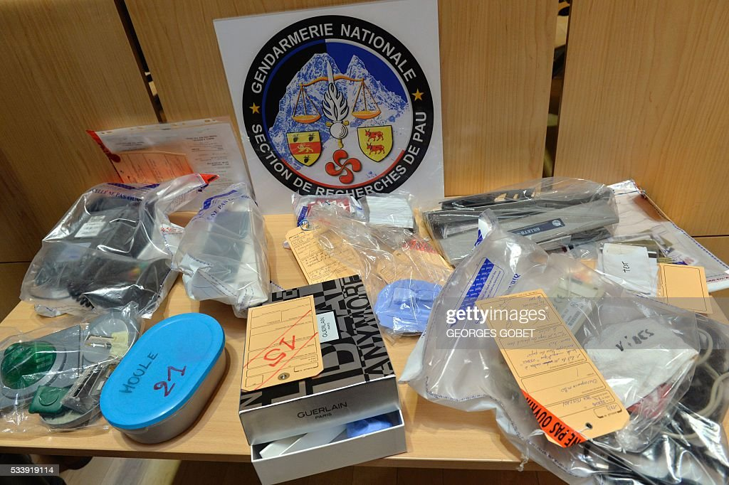 A picture shows objects used by a network of cash machine hackers displayed in the courthouse of Bordeaux, southwestern France, on May 24, 2016. Eleven people belonging to a cash machine hacking network, suspected of pirating data from thousands of bank cards for a damage of around 1 million euros, have been arrested mid-May in the south of France, the Bordeaux prosecutor's office said on May 24, 2016. / AFP / GEORGES