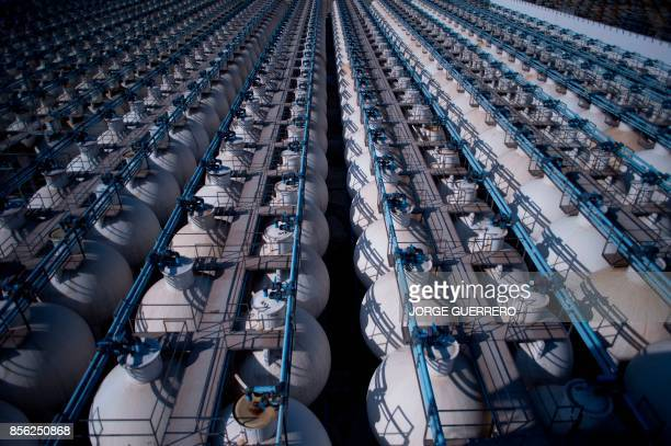 Picture shows olive tanks in 'Agro Sevilla' olive manufacturing company in La Roda de Andalucia on September 29 2017 / AFP PHOTO / JORGE GUERRERO