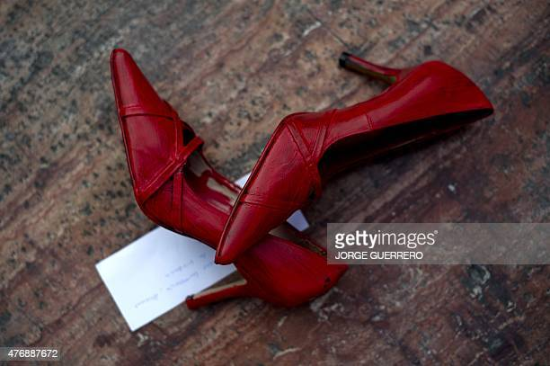 Picture shows one of the 745 pairs of red shoes that lie at the Constitucion square in Malaga where the Mexican artist Elina Chauvet's...