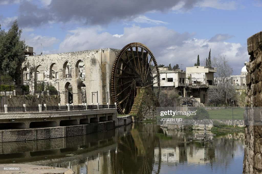 A picture shows one of the ancient water wheels, or norias, along the Orontes River in Hama in central Syria, on March 13, 2017. /