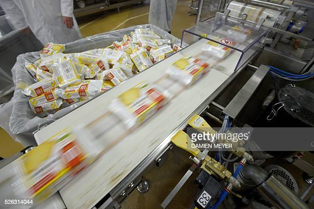 A picture shows packages in the production line of the 'petit beurre' biscuit in the factory of French biscuit manufacturer LU in La HayeFouassiere...