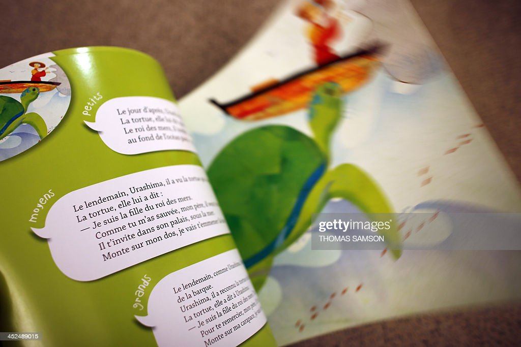 A picture shows pages of the 'Oralbum' children's book 'Urashima et la princesse des mers' (Urashima and the Sea Princess), written by Virginie Leroy and illustrated by Mizuho Fujisawa, on November 29, 2013 in Paris. The book is part of a collection presented during the 2013 'Children's Book and Press Fair' of Montreuil, outside Paris, which offers texts written in an oral language in order to adapt to the comprehension of children. AFP PHOTO / THOMAS SAMSON