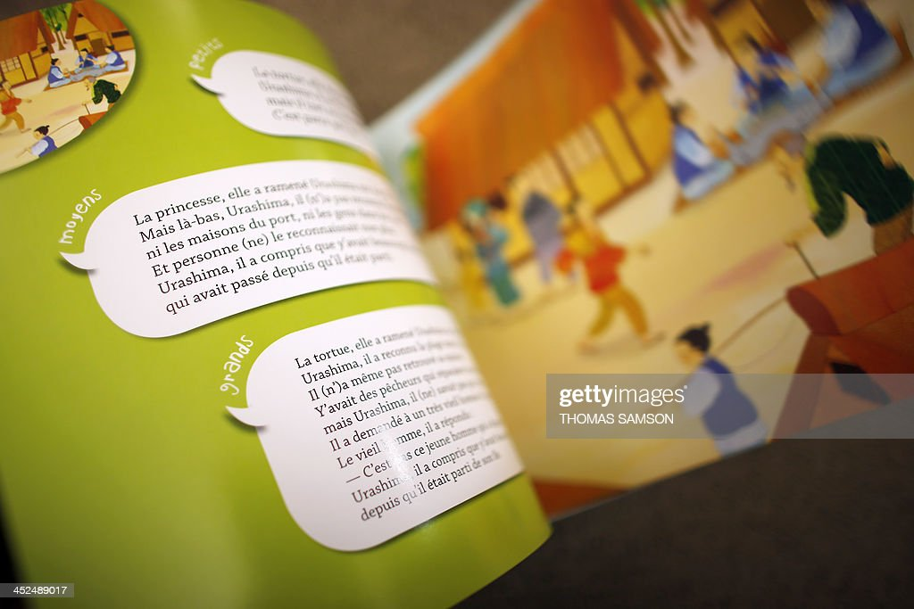 A picture shows pages of the 'Oralbum' children's book 'Urashima et la princesse des mers' (Urashima and the Sea Princess), written by Virginie Leroy and illustrated by Mizuho Fujisawa, on November 29, 2013 in Paris. The book is part of a collection presented during the 2013 'Children's Book and Press Fair' of Montreuil, outside Paris, which offers texts written in an oral language in order to adapt to the comprehension of children.