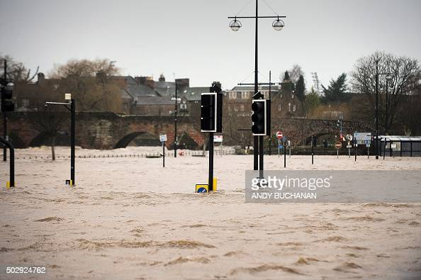 A picture shows pedestrian areas and roads flooded along the River Nith that burst its banks in Dumfries southern Scotland on December 30 2015 after...
