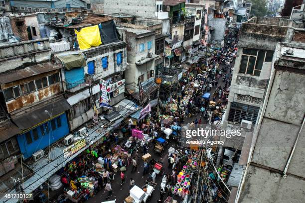 Picture shows people on the busy streets of New Delhi's Shahjahanabad the walled old city part of India's capital on March 31 2014 With its crumbling...