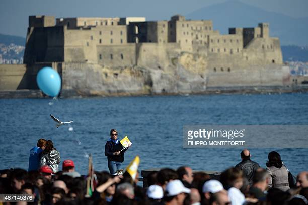 A picture shows people waiting for Pope Francis along the sea with the Castel dell'Ovo in the background during a pastoral visit on March 21 2015 in...