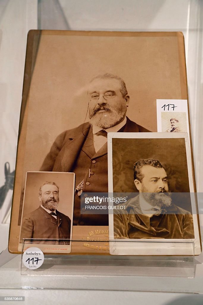 A picture shows photographs of French physician Adrien Proust, the father of French writer Marcel Proust, during the presentation of Marcel Proust's personal archives ahead of an auction at Sotheby's in Paris, on May 30, 2016. / AFP / FRANCOIS