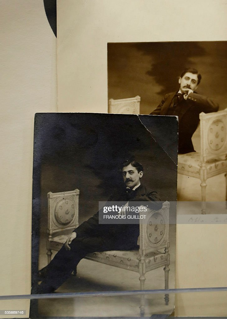 A picture shows photographs of French writer Marcel Proust in 1896 during the presentation of Proust's personal archives ahead of an auction at Sotheby's in Paris, on May 30, 2016. / AFP / FRANCOIS