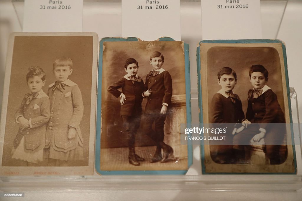 A picture shows photographs of Marcel Proust and his brother Robert, circa 1882, during the presentation of personal archives of French writer Marcel Proust, ahead of an auction at Sotheby's in Paris, on May 30, 2016. / AFP / FRANCOIS
