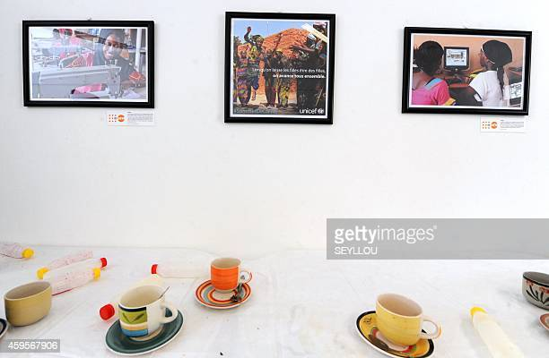 A picture shows photos at an exhibition aiming for more equality between men and women on November 25 2014 at the Theodore Monod museum in Dakar on...