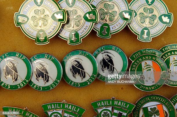 A picture shows pin badges on a stall outside Celtic Park in Glasgow on December 17 2016 before the Scottish Premiership football match between...