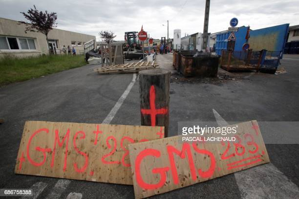 A picture shows placards and a barrier set up at the plant of automotive supplier GMS Industry where around 280 jobs are on the line in La...