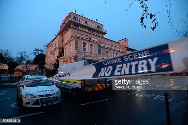 A picture shows police tape cordoning off the Regency Airport Hotel in Dublin on February 5 2016 following a shooting incident One man has died and...