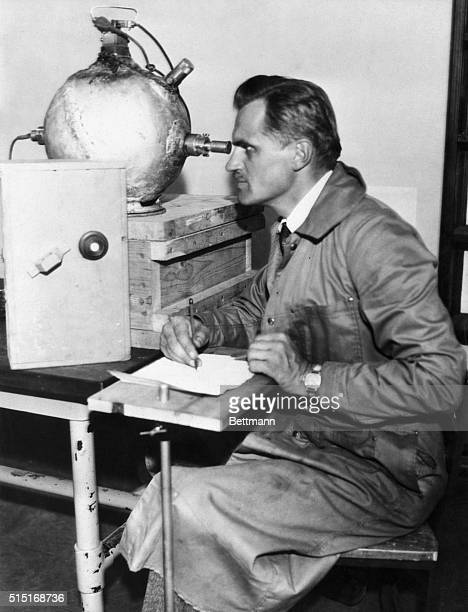 Picture shows Professor Arthur Compton who is shown studying cosmic rays